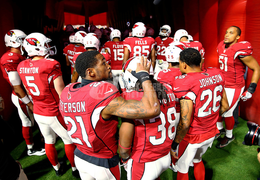 Jan 16, 2016; Glendale, AZ, USA; Arizona Cardinals cornerback Patrick Peterson (21) embraces running back Andre Ellington (38) prior to the game against the Green Bay Packers during an NFC Divisional round playoff game at University of Phoenix Stadium. Mandatory Credit: Mark J. Rebilas-USA TODAY Sports