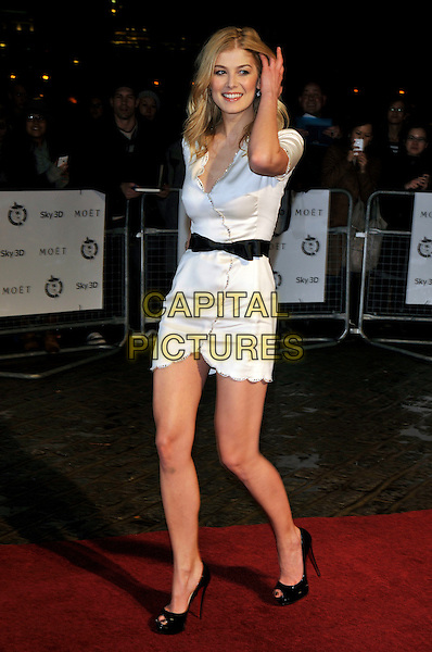 ROSAMUND PIKE.London Critics' Circle Film Awards at BFI Southbank, London, England..February 10th 2011.ALFS full length black white wrap dress belt peep toe shoes hand.CAP/PL.©Phil Loftus/Capital Pictures.