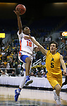 Bishop Gorman's Zaon Collins shoots over  Bishop Manogue defender Mateo Reviglio during the 4A NIAA state basketball championship game in Reno, Nev., on Friday, Feb. 23, 2018. Gorman won 62-41. Cathleen Allison/Las Vegas Review-Journal