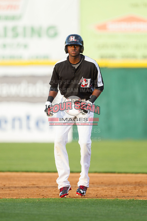Lewis Brinson (25) of the Hickory Crawdads takes his lead off of first base against the Charleston RiverDogs at L.P. Frans Stadium on June 2, 2014 in Hickory, North Carolina.  The Crawdads defeated the RiverDogs 9-6.  (Brian Westerholt/Four Seam Images)