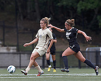 Boston College midfielder Kristen Mewis (19) passes the ball as University of Central Florida midfielder Madison Barney (22) closes. After two overtime periods, Boston College tied University of Central Florida, 2-2, at Newton Campus Field, September 9, 2012.