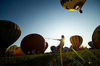 READINGTON, NJ - JULY 27: A participant holds tie a balloon as others get ready during the QuickCheck New Jersey Festival of Ballooning on July 27, 2019 in Readington, NJ. More than 100 hot air balloons are taking part in the show where at least 165.000 are expected to attend.  (Photo by Eduardo MunozAlvarezVIEWpress)