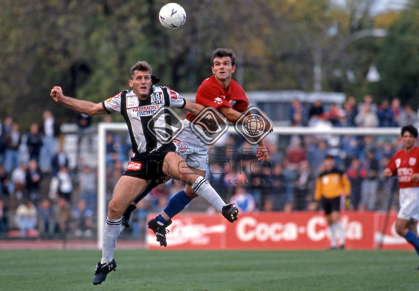 Damien Mori (AC) fights with (MK)<br /> Grand Final - Adelaide City vs Melbourne Knights<br /> 1992 Coca Cola National Soccer League<br /> May 3rd 1992 / Olympic Park - Melbourne<br /> &copy; Sport the library / Ian Kenins