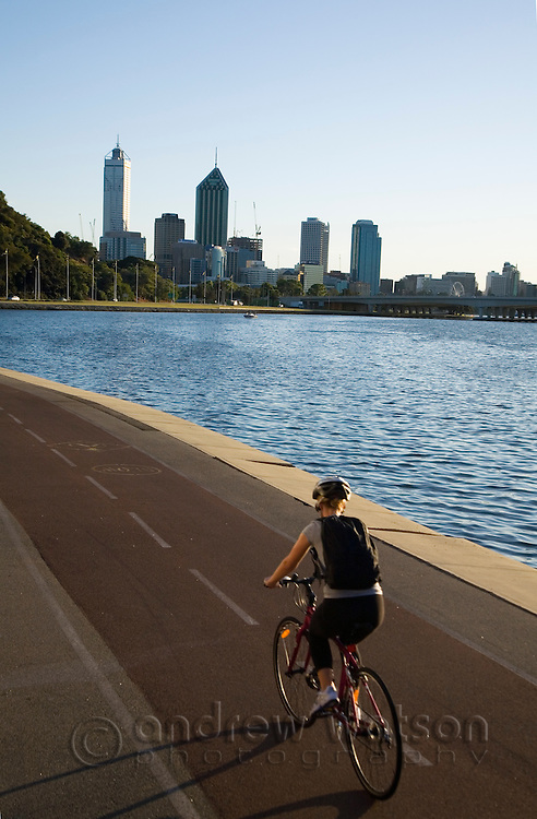 Early morning cyclist on the Perth riverside.  Perth, Western Australia, AUSTRALIA.