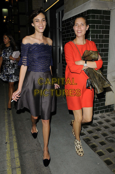 Alexa Chung &amp; guest<br /> Alexa Chung's book launch party, Liberty London, London, England.<br /> September 4th, 2013<br /> full length blue red orange lace off the shoulder top skirt black dress leopard print shoes hands arms crossed folded <br /> CAP/CAN<br /> &copy;Can Nguyen/Capital Pictures