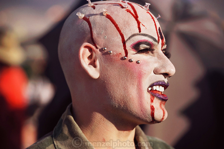Perennial Burning Man attendee Nambla the clown (NAMBLA is an acronym for North American Man Boy Love Association) sports fake blood and push pins. Burning Man is a performance art festival known for art, drugs and sex. It takes place annually in the Black Rock Desert near Gerlach, Nevada, USA..