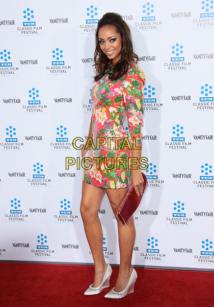 "AMBER STEVENS .""A Star Is Born"" World Premiere-Arrivals held at Grauman's Chinese Theatre, Hollywood, California, USA, .22nd April 2010..full length red green white floral print flower dress pink clutch bag silver  shoes .CAP/ADM/TC.©T. Conrad/AdMedia/Capital Pictures."