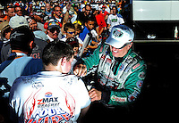 Sept. 18, 2010; Concord, NC, USA; NHRA funny car driver John Force signs autographs during qualifying for the O'Reilly Auto Parts NHRA Nationals at zMax Dragway. Mandatory Credit: Mark J. Rebilas /