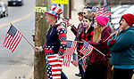 WATERBURY CT. 31 December 2018-123118SV02-Flag wavers stand outside St. Francis Xavier Church during the funeral of Zeqir &quot;Ziggy the Flag Man&quot; Berisha in Waterbury Monday. <br /> Steven Valenti Republican-American