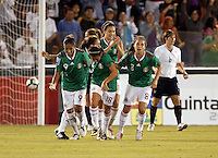 Maribel Domiguez of Mexico (L) during the semifinal match of CONCACAF Women's World Cup Qualifying tournament held at Estadio Quintana Roo in Cancun, Mexico. Mexico 2, USA 1.