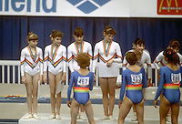 (L-R) Daniela Silivas, Celestina Popa, Camelia Voinea, Ecaterina Szabo, Laura Cutina and Eugenia Golea of  Romania greet members of East German team during team medals ceremony at 1985 World Championships in women's artistic gymnastics at Montreal, Canada in mid-November, 1985.  Photo by Tom Theobald.