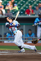 Stephen Bruno (11) of the Tennessee Smokies follows through on his swing against the Mississippi Braves at Smokies Park on July 22, 2014 in Kodak, Tennessee.  The Smokies defeated the Braves 8-7 in 10 innings. (Brian Westerholt/Four Seam Images)