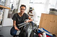 """Das Berliner Start-up """"mimycri"""" produziert Taschen aus den Gummiplanen gestrandeter Fluechtlingsboote.<br /> Statt Griechenlands Straende im Muell der gestrandeten Fluechtlingsboote ersticken zu lassen, stellt das Berliner Unternehmen """"mimycri"""" daraus Taschen und Rucksaecke her und bietet Fluechtlingen eine Chance auf Normalitaet und Regelmaessigkeit.<br /> Im Bild: Nora Azzaoui, 30-Jaehrige Unternehmensberaterin aus Berlin, mit einem Rucksack aus dem Schlauschbootmaterial. Im Hintergrund, Abid Ali, gefluechteter Schneider aus Pakistan.<br /> 8.8.2017, Berlin<br /> Copyright: Christian-Ditsch.de<br /> [Inhaltsveraendernde Manipulation des Fotos nur nach ausdruecklicher Genehmigung des Fotografen. Vereinbarungen ueber Abtretung von Persoenlichkeitsrechten/Model Release der abgebildeten Person/Personen liegen nicht vor. NO MODEL RELEASE! Nur fuer Redaktionelle Zwecke. Don't publish without copyright Christian-Ditsch.de, Veroeffentlichung nur mit Fotografennennung, sowie gegen Honorar, MwSt. und Beleg. Konto: I N G - D i B a, IBAN DE58500105175400192269, BIC INGDDEFFXXX, Kontakt: post@christian-ditsch.de<br /> Bei der Bearbeitung der Dateiinformationen darf die Urheberkennzeichnung in den EXIF- und  IPTC-Daten nicht entfernt werden, diese sind in digitalen Medien nach §95c UrhG rechtlich geschuetzt. Der Urhebervermerk wird gemaess §13 UrhG verlangt.]"""