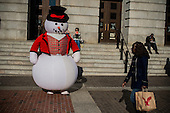 Frosty the snowman watches the scene outside the National Portrait Gallery in downtown Washington, DC.