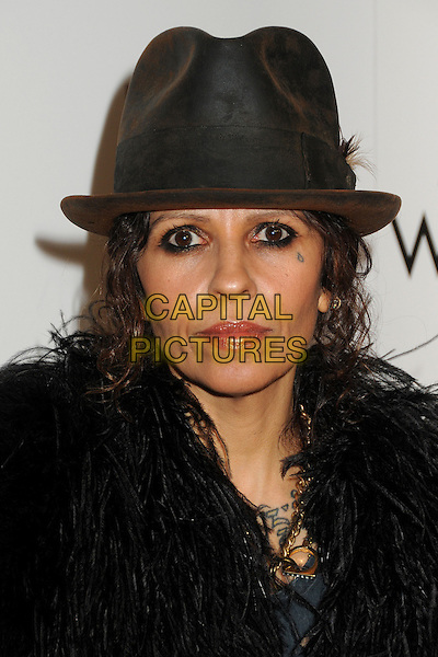 "Linda Perry.LA Gay & Lesbian Center's ""An Evening With Women"" 2013 held at the Beverly Hilton Hotel, Beverly Hills, California, USA, 18th May 2013..portrait headshot tear drop teardrop tattoo on face  black  fur jacket coat hat  .CAP/ADM/BP.©Byron Purvis/AdMedia/Capital Pictures"