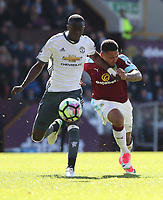 Manchester United's Eric Bailly is tackled by Burnley's Andre Gray<br /> <br /> Photographer Rachel Holborn/CameraSport<br /> <br /> The Premier League - Burnley v Manchester United - Sunday 23rd April 2017 - Turf Moor - Burnley<br /> <br /> World Copyright &copy; 2017 CameraSport. All rights reserved. 43 Linden Ave. Countesthorpe. Leicester. England. LE8 5PG - Tel: +44 (0) 116 277 4147 - admin@camerasport.com - www.camerasport.com
