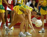 16.11.2007 Australian Julie Prendergast and England's Karen Atkinson in action during the Australia v England match at the New World Netball World Champs held at Trusts Stadium Auckland New Zealand. Mandatory Photo Credit ©Michael Bradley.
