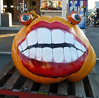 Huge Happy pumpkin greets customers of the gas station, Damariscotta Maine, 2010