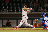 Scottsdale Scorpions left fielder Austin Listi (23), of the Philadelphia Phillies organization, follows through on his swing in front of catcher Jhonny Pereda (6) during an Arizona Fall League game against the Mesa Solar Sox at Sloan Park on October 10, 2018 in Mesa, Arizona. Scottsdale defeated Mesa 10-3. (Zachary Lucy/Four Seam Images)