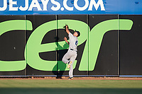 Tampa Tarpons center fielder Ben Ruta (6) attempts to catch a fly ball at the wall during a game against the Dunedin Blue Jays on June 2, 2018 at Dunedin Stadium in Dunedin, Florida.  Dunedin defeated Tampa 4-0.  (Mike Janes/Four Seam Images)