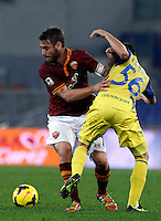 Calcio, Serie A: Roma vs ChievoVerona. Roma, stadio Olimpico, 31 ottobre 2013.<br /> AS Roma midfielder Daniele De Rossi, left, and ChievoVerona midfielder Perparim Hetemaj, of Finland, fight for the ball during the Italian Serie A football match between AS Roma and ChievoVerona at Rome's Olympic stadium, 31 October 2013.<br /> UPDATE IMAGES PRESS/Isabella Bonotto