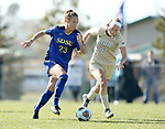 BROOKINGS, SD, OCTOBER 21: Annie Williams #23 from South Dakota State pushes the ball in past Kelli Keller 22 from Oral Roberts during their match Sunday afternoon at Fischback Soccer Field in Brookings. (Dave Eggen/Inertia)