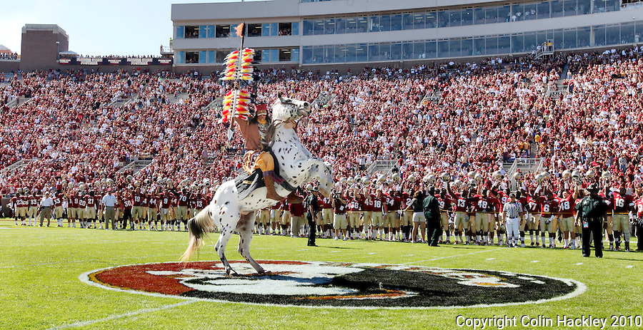 TALLAHASSEE, FL 10-FSU-BC 101610 FB10 CH-Florida State Mascot Chief Osceola plants the spear at midfield prior to the Boston College game Saturday at Doak Campbell Stadium in Tallahassee. .COLIN HACKLEY PHOTO