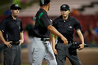 Dayton Dragons manager Luis Bolivar (14) argues a call with umpires Emma Charlesworth-Seiler (right) and A.J. Choc during a Midwest League game against the Kane County Cougars on July 20, 2019 at Northwestern Medicine Field in Geneva, Illinois.  Dayton defeated Kane County 1-0.  (Mike Janes/Four Seam Images)