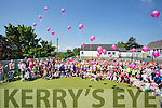 Student let off pink balloons for people who weren't able be a the event  at the  Donal Walsh Spa 6k Challenge and family fun day at Spa NS on Sunday