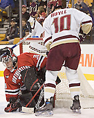 Doug Jewer, Stephen Gionta, Brian Boyle - The Boston College Eagles defeated the Northeastern University Huskies 5-2 in the opening game of the 2006 Beanpot at TD Banknorth Garden in Boston, MA, on February 6, 2006.