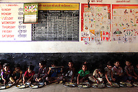 Children receiving one of two daily meals provided at an Anganwadi 'village nutrition centre' in Madhya Pradesh, India.<br />