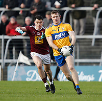 26th January 2020; TEG Cusack Park, Mullingar, Westmeath, Ireland; Allianz Football Division 2 Gaelic Football, Westmeath versus Clare; Ciaran Russell (Clare) holds on to the ball under pressure from David Lynch (Westmeath)