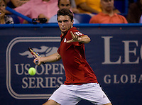 Giles Simon sets up for a forehand during the Legg Mason Tennis Classic at the William H.G. FitzGerald Tennis Center in Washington, DC.  Giles Simon defeated Andy Roddick in straight sets in a thunderstorm delayed evening session.