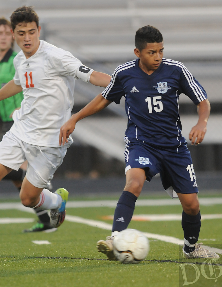 NWA Democrat-Gazette/ J.T. WAMPLER --  Springdale Har-Ber High School's Christian Vega looks to pass while Rogers Heritage's Christian Banuelos closes in Tuesday March 30, 2015 in Rogers.