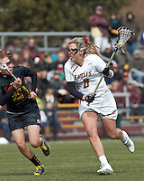 Boston College attacker Covie Stanwick (8) on the attack as University of Maryland defender Melissa Diepold (15) closes..University of Maryland (black) defeated Boston College (white), 13-5, on the Newton Campus Lacrosse Field at Boston College, on March 16, 2013.