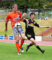 Richard McLay tries to get past towering Waikato player/coach Che Bunce (left)..NZFC soccer  - Team Wellington v Waikato FC at Newtown Park, Wellington. Sunday, 20 December 2009. Photo: Dave Lintott/lintottphoto.co.nz