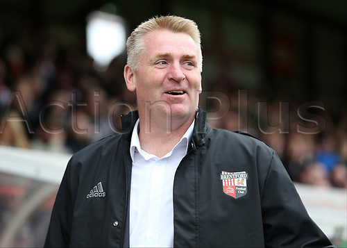 April 14th 2017,  Brent, London, England; Skybet Championship football, Brentford versus Derby County; Dean Smith, the Brentford manager smiling at the touchline before kick off