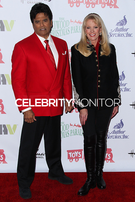 HOLLYWOOD, CA - DECEMBER 01: Erik Estrada, Laura McKenzie arriving at the 82nd Annual Hollywood Christmas Parade held at Hollywood Boulevard on December 1, 2013 in Hollywood, California. (Photo by Xavier Collin/Celebrity Monitor)