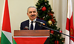 Palestinian Prime Minister Mohammad Ishtayeh, speaks during a dinner hosted by the Ramallah Church Council, in the West Bank city of Ramallah, on December 30, 2019. Photo by Prime Minister Office
