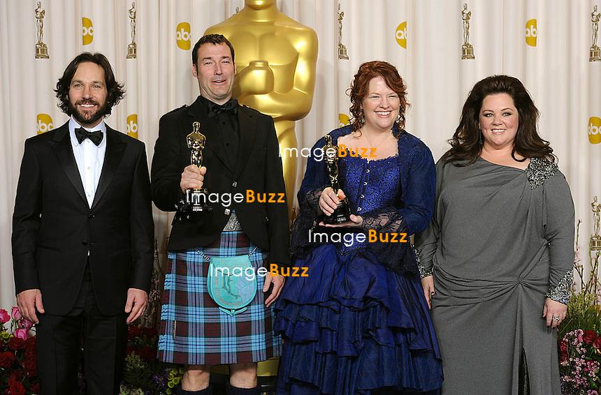 Mark Andrews (second left) and Brenda Chapman with the Oscar for Best Animated Feature for Brave alongside Paul Rudd (far left) and Melissa McCarthy (far right) at the 85th Academy Awards at the Dolby Theatre, Los Angeles.