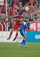 03 July 2013: Montreal Impact defender Alessandro Nesta #14 and Toronto FC midfielder Luis Silva #11in action during an MLS game between the Montreal Impact and Toronto FC at BMO Field in Toronto, Ontario Canada.<br /> The game ended in a 3-3 draw.
