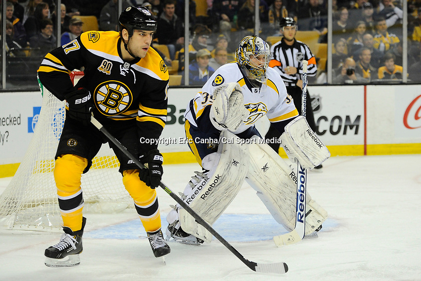 January 2, 2014 - Boston, Massachusetts, U.S. - Boston Bruins left wing Milan Lucic (17) and Nashville Predators goalie Marek Mazanec (39) in game action during the NHL game between Nashville Predators and the Boston Bruins held at TD Garden in Boston Massachusetts. Boston defeated Nashville 3-2 in overtime. Eric Canha/CSM