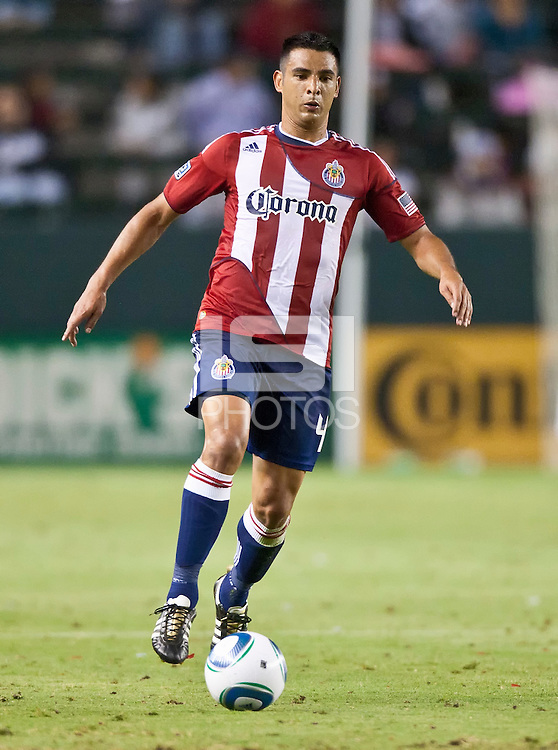 CARSON, CA – June 18, 2011: Chivas USA defender Michael Umana (4) during the match between Chivas USA and FC Dallas at the Home Depot Center in Carson, California. Final score Chivas USA 1, FC Dallas 2.