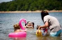 NWA Democrat-Gazette/CHARLIE KAIJO (From center left)  Ashley Latta embraces Alexis Latta, 10, of Rogers during a warm afternoon, Sunday, July 8, 2018 at the Prairie Creek Marina in Rogers.