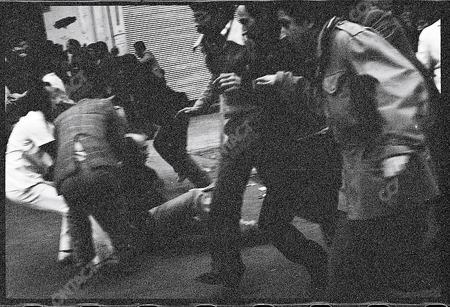 Wounded demonstrators on the ground after the army fires on the funeral cortege. Tehran, December 27, 1978