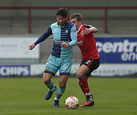 Joe Jacobson of Wycombe Wanderers  is tackled by Aaron McGowan of Morecambe during the Sky Bet League 2 match between Morecambe and Wycombe Wanderers at the Globe Arena, Morecambe, England on 29 April 2017. Photo by Stephen Gaunt / PRiME Media Images.