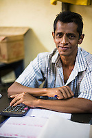 Business owner at Dambulla wholesale market, Dambulla, Central Province, Sri Lanka, Asia. This is a photo of a business owner at Dambulla wholesale market, Dambulla, Central Province, Sri Lanka, Asia.