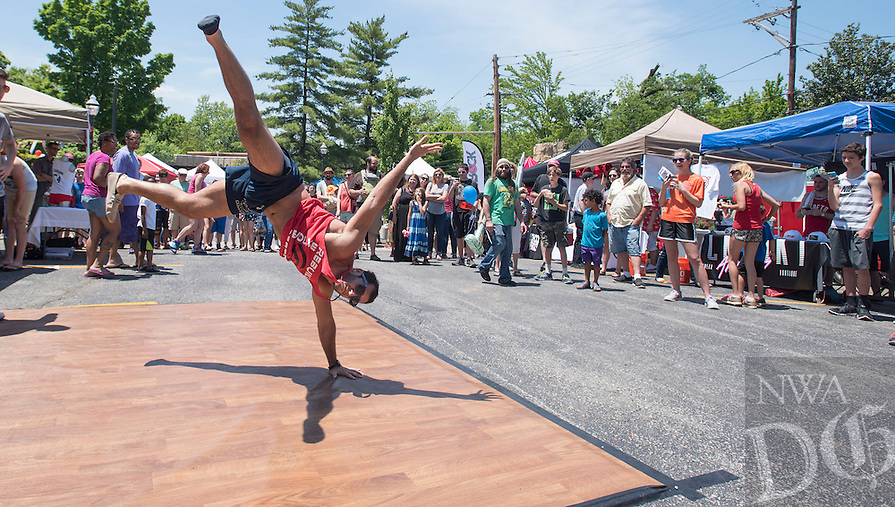 NWA Democrat-Gazette/J.T. WAMPLER Corey DeAngelis of Fayetteville shows off some dance moves Sunday May 22, 2016 at the 6th Annual Block Street Block Party in Fayetteville. Several thousand people attended the annual street party with events like waiter races, beer gardens, live music and vendors.