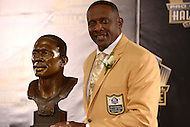 Canton, Ohio - August 6, 2015: Former NFL player Tim Brown poses with his bust during the 2015 Pro Football Hall of Fame enshrinement in Canton, Ohio August 6, 2015. At time of his retirement, Brown amassed 14,934 receiving yards, second-highest total in NFL history. (Photo by Don Baxter/Media Images International)
