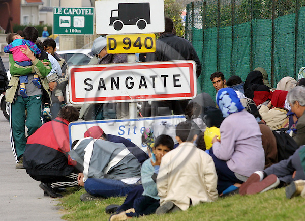 SANGATTE - FRANCE -10 SEPTEMBER 2001 --Refugees in the village of Sangatte waiting at the bus stop for the local bus to take them to the Calais the port or the Channel Tunnel terminal, from where they will attempt to cross over to the UK. -- PHOTO: JUHA ROININEN / EUP-IMAGES